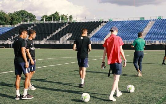 Hudson Bethea kicks some soccer balls around with The Greenville Triumph