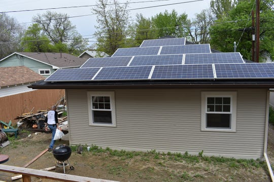 A garage with rooftop solar panels to generate electricity for a nearby house is seen in Billings on May 23.