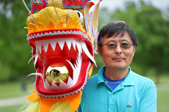 Eugene Zhen is the dragon head of the Chinese Dragon Group, as seen during the Indianapolis Chinese Community Center Inc,'s (ICCCI) annual Chinese School/community center picnic, at the James A. Dillon Park in Noblesville, Sunday, May 19, 2019.  He will lead the dragon during the 2019 IPL 500 Festival Parade.
