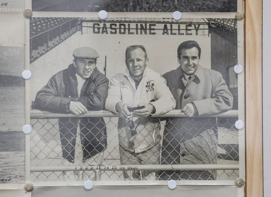 Racing driver Ronnie Duman, center, is the father of Rick Duman, owner of Turn 4 Restorations in Brownsburg. He is flanked by  Jackie Stewart, left, and Lorenzo Bandini, right, in this photo taken outside Gasoline Alley at  Indianapolis Motor Speedway. This photo hangs at Rick Duman's business.