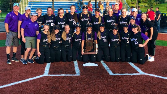 Brownsburg softball team poses with the sectional trophy after topping Plainfield, 1-0, in Wednesday's sectional final at Mooresville.