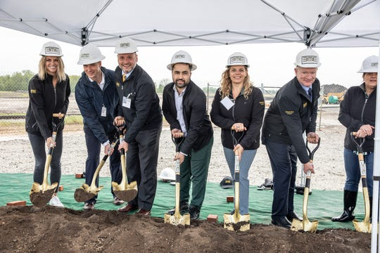 Employees and board members of Brightmark Energy shovel dirt at the groundbreaking ceremony for its new chemical recycling facility in Ashley, Ind. on Wednesday, May 22, 2019. This plant will be the first of its kind in the U.S. and will turn plastic waste -- such as bags, bottles and toys -- into diesel fuel and industrial wax. The plant is expected to open in 2021.