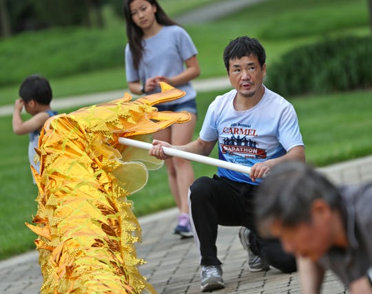Sijiu Liu and others prepare the Chinese Dragon for dance, during the Indianapolis Chinese Community Center Inc,'s (ICCCI) annual Chinese School/community center picnic, at the James A. Dillon Park in Noblesville, Sunday, May 19, 2019.