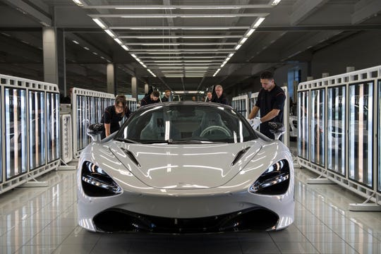 A McLaren 720S is seen on a production line as Britain's Prince William, visits the McLaren Automotive Production Centre, in Woking, England, Tuesday, Sept. 12, 2017, During the visit the prince toured the technology centre and production centre where he got to see McLaren cars throughout the years as well as walk the factory floor to view the building of their commercial cars and speak to employees.  (Chris J Ratcliffe/Pool Photo via AP)