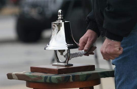 Randy Sichting is ringing the clock after every name of a fall is called during the weekly Taps on the Square in Martinsville on Friday, May 3, 2019