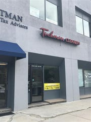The front door was locked at a dark and empty Tuchman Cleaners location Downtown, on East Ohio Street, on Thursday, May 23, 2019.