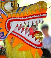 "The Chinese Dragon pauses with ""dancing"" during the Indianapolis Chinese Community Center Inc,'s (ICCCI) annual Chinese School/community center picnic, at the James A. Dillon Park in Noblesville, Sunday, May 19, 2019."