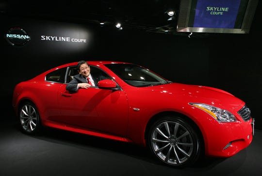 Nissan Motor Co. Chief Operating Officer Toshiyuki Shiga introduces the Japanese automaker's new Nissan Skyline coupe at Nissan's showroom in Tokyo Tuesday, Oct. 2, 2007. (AP Photo/David Guttenfelder)
