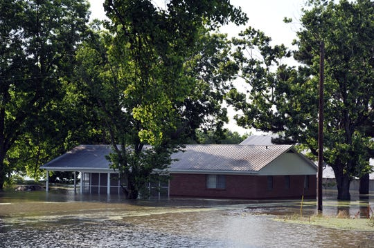 A house along U.S. 61 in the south Delta sits inundated by flood water Wednesday, May 22.