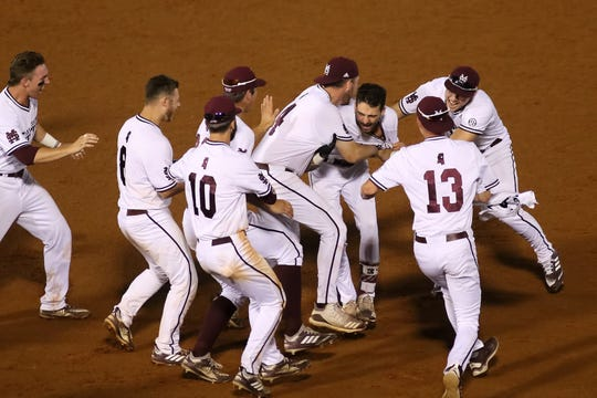 Mississippi State players celebrate the Bulldogs' 6-5 walk-off victory over LSU in the 2019 SEC Tournament. MSU and LSU played in the longest game in tournament history.