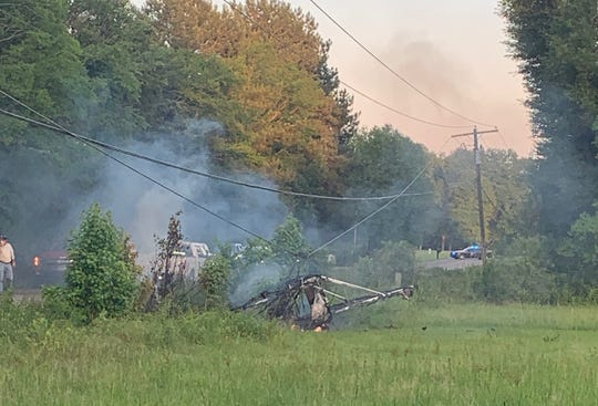 A small aircraft crashed into power lines and caught fire near Terry, Mississippi.