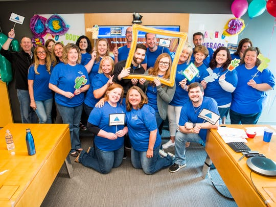 """SmartBank celebrated being name a """"Top Workplace"""" with a taco party at their headquarters in Knoxville on Friday, May 17, 2019. In addition to lunch, staff members played games and took selfies at a selfie station created for the lunch."""