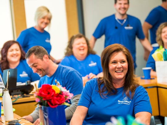 """SmartBank employees celebrated their """"Top Workplace"""" honor with a taco party at their headquarters in Knoxville on Friday, May 17, 2019. In addition to lunch, staff members played games and took selfies at a selfie station created for the lunch."""