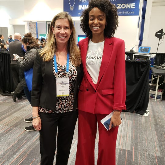 Lindsey Lieb, founder of Happego (left), poses with Dr. Jessica Ann Clemons, a world-renowned doctor, entrepreneur and social influencer in the mental health industry, at the American Psychiatry Association's Innovation Zone accelerator program.