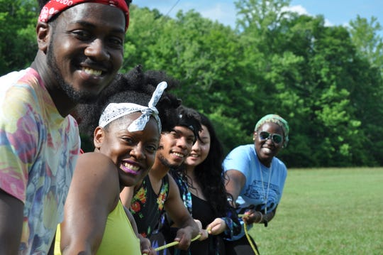 Interns are called servant leaders. Here they participated in a team building exercise as part of a Freedom Schools training conference at the Children's Defense Fund campus at Haley Farm in Clinton.