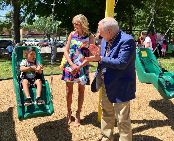 Five-year-old Gerardo Reyes shares his approval of the swing with LHP Capital Chairman Phil Lawson and CEO Carey Parker. LHP helped fund Cedar Bluff Preschool's adaptive playground. May 2019