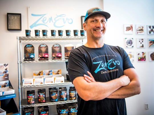 Eddie Raymond, president and co-owner of ZenEvo Chocolate, pictured inside Eddie's Health Shoppe in downtown Knoxville on Thursday, May 23, 2019.