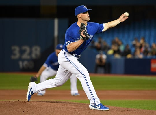 Toronto Blue Jays starting pitcher Clayton Richard (2) delivers a pitch against Boston Red Sox in the first inning at Rogers Centre.