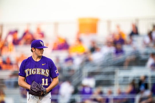 LSU baseball player Landon Marceaux stands on the mound.