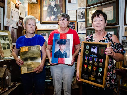 Beverly Theall, Dollie Babineaux and Casa Soirez hold items related to their brother Pvt. Farrell Vice, who was killed in action 50 years ago in Vietnam. He will be honored at a service at the Acadian Museum in Erath Friday, May 24, 2019.