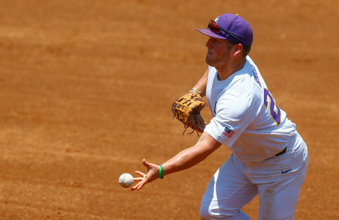 LSU first baseman Cade Beloso tosses to first for the out on Auburn's Edouard Julien during the second inning of an NCAA college baseball game in the Southeastern Conference tournament, Thursday, May 23, 2019, in Hoover, Ala. (AP Photo/Butch Dill)