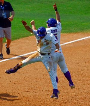 LSU's Josh Smith (4) and Drew Bianco (5) celebrate their win over Auburn in an NCAA college baseball game at the Southeastern Conference tournament, Thursday, May 23, 2019, in Hoover, Ala. (AP Photo/Butch Dill)