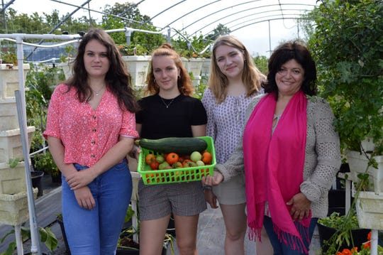 French interns Charlotte Pringot and Lola Dubois are teaming up with Chef Agnes Capello to host a French Brunch Fundraiser June 8 at Envision da Berry. (From left to right: Lola Dubois, Charlotte Pringot, Abby Langford, and Chef Agnes Capello)