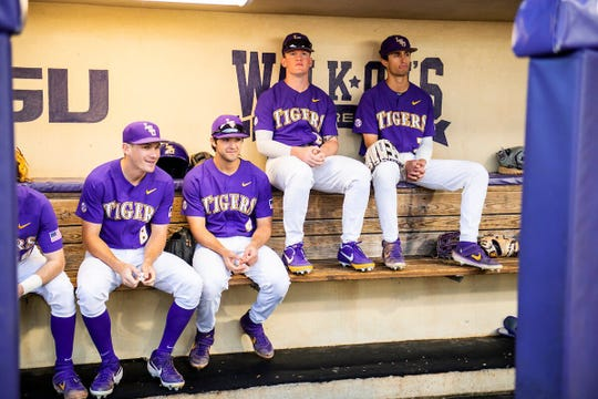 Members of the LSU baseball team sit together before the start of their game against Mississippi State on May 22, 2019, in Hoover, Alabama.