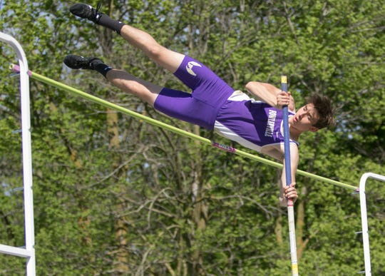 Fowlerville's Garett Shermoe took second in the pole vault in the CAAC Red track and field meet in Mason on Wednesday, May 22, 2019.