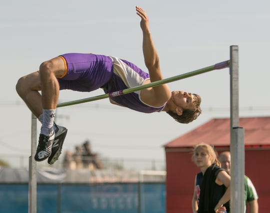 Hayden Schloemp of Fowlerville won the high jump in the CAAC Red track and field meet in Mason on Wednesday, May 22, 2019.