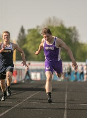 Fowlerville's Kaleb Chappell won the 100, 200 and was on two winning relays in the CAAC Red track and field meet in Mason on Wednesday, May 22, 2019.