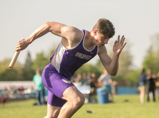 Sophomore Kaleb Chappell runs the lead leg on Fowlerville's record-setting 800-meter relay team.