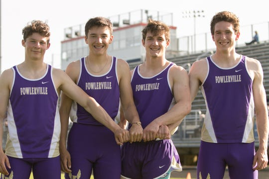 Fowlerville's 800-meter relay team of, from left, Kaleb Chappell, Randall Kuch, Tom Salois and Nick Reason broke a school record which stood since 1965.