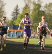 Fowlerville's Nick Reason (center) won the 400-meter run in the CAAC Red track and field meet in Mason on Wednesday, May 22, 2019.