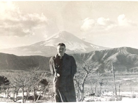Carl Thompson in front of Mount Fuji, Japan, in May 1956.