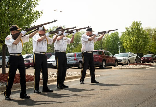 Members of the VFW Post 701 Color Guard rifle team fire during a three-volley salute at former U.S. Marine Dale Hansen's funeral on Saturday, May 18, 2019, at South Church in Lansing.  The rifleman fire three rounds each into the air as a final salute to fallen veterans. The tradition originated from past wars when enemies would call a temporary cease-fire to remove their dead from the battleground.  Once the dead were removed, three rifle shots were fired into the air signifying battle could resume.