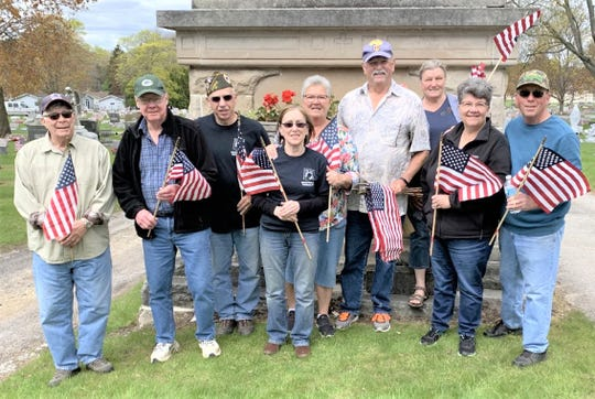 AMVETS Post 99 members and friends recently honored fallen soldiers by placing flags at their graves in Calvary Cemetery in Manitowoc.