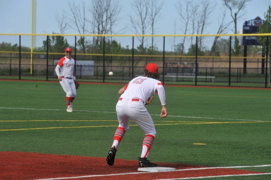 Shelby's Evan Bogner throws to McGwire Albert for the out.