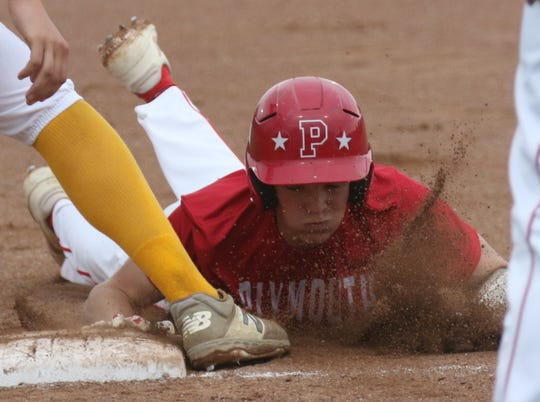 Plymouth's Walker Elliott dives back to first base on a pick-off attempt during a 6-3 loss to Colonel Crawford on Wednesday night.
