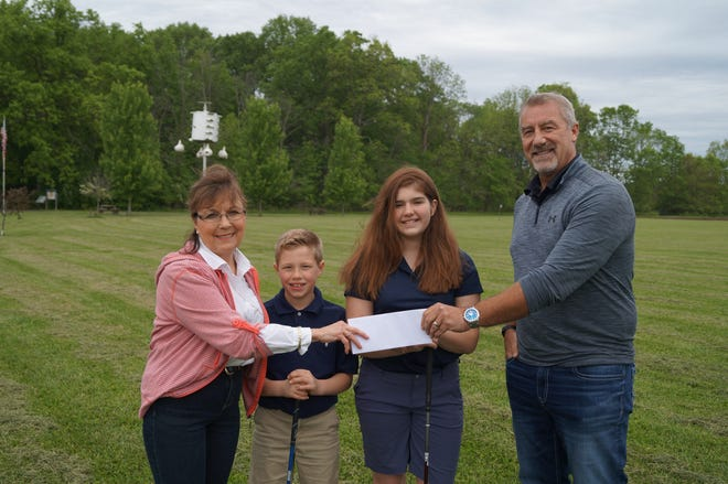 Heart of Ohio Junior Golf Association President Carol Markey joins players Matt and Maura Murphy to accept a $1,000 donation from Marion County Youth Foundation President Steve Conway for the MCYF Merit Scholarship. The scholarship goes to a HOJGA golfer between the ages of 16 and 18 who shows the best manners, etiquette, repsect, integrity and trust during the seven-tournament tour.