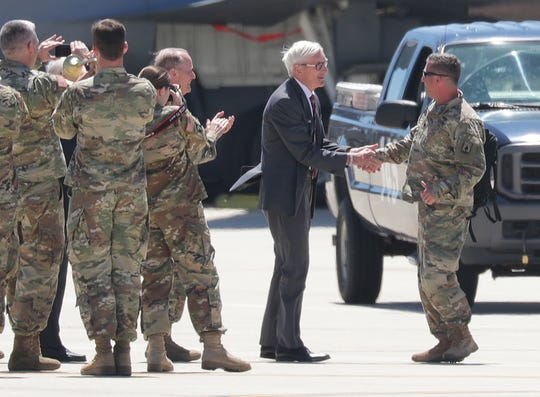 Wisconsin Gov. Tony Evers greets Wisconsin Army National Guard soldiers at the 128th Air Refueling Wing in Milwaukee on Thursday.