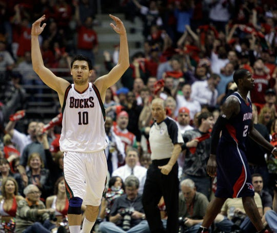 Milwaukee Bucks' Carlos Delfino reacts after sinking a 3-point basket against the Atlanta Hawks in the 2010 playoffs.
