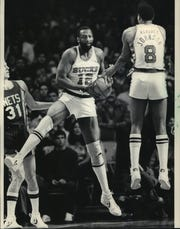 Bob Lanier of the Milwaukee Bucks and teammate Marques Johnson went in the air to secure a rebound during Sunday's NBA playoff game against the New Jersey at the Arena.