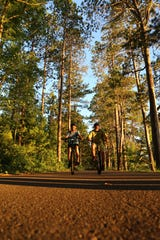 Cyclists ride on the Heart of Vilas trail system through Vilas County.