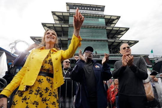 """Savannah Guthrie, Al Roker and Tom Hanks, from left, listen as Sheryl Crow performs on NBC's """"Today"""" show at the Indianapolis Motor Speedway on Thursday morning. The network will carry the Indianapolis 500 for the first time Sunday."""