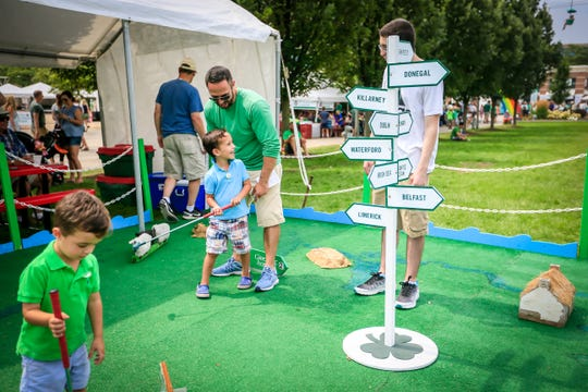 One of the family activities available at Milwaukee's Irish Fest is miniature golf.