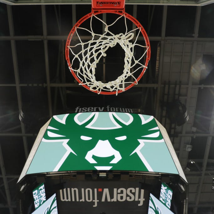 """Fiserv CEO Jeff Yabuki says having the company's name on the Milwaukee Bucks' arena is """"elevating"""" its brand. The company's name is all over the arena, including multiple places on the scoreboard."""