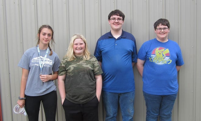 In preparation for the Baxter County Fair, Baxter County 4-H members recently chose lots for feeder pigs. After selection, feeder pigs went home with 4-H members. 4-H'ers who received a feeder pig were: (from left) Brooke Lawing, Emma Joplin, Bentley Branscumand Billy Branscum.In September, 4-H youth will show their market hogs at the fair. Awards will be given for grand champion and reserve grand champion market hogs, as well as champion and reserve champion hogs in each weight class.Sponsors for this year's 4-H Market Hog project are Arvest Bank, Integrity First Bank, KPFM/KKTZ/KOMT radio stations, KTLO-AM/FM/Oldies 101.7 radio stations, North Arkansas Electric Co-op and Platinum Roadcase Productions, Inc.