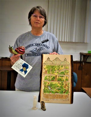 At the 40th annual North Arkansas Woodcarver's Show, with wood turners and and carvers at the Baxter County Fair Grounds, there were finished works that became pieces of art.A featured woodcarver from NAWC is Margaret Killen, who is displaying a Blue Ribbon for her Realist Aquatic Animal carving of a snail;awoodburning carving of a vertical green house with color; and two small carvings, ashoe and a critter. Killenis a master with detail placed into her carvings. If interested in woodcarving, the NAWC meets on Thursdays morningsat the Ozark VFW Post 3246, located at the corner of 7th and Gray streets,just west of the Mountain Home Fire Department.