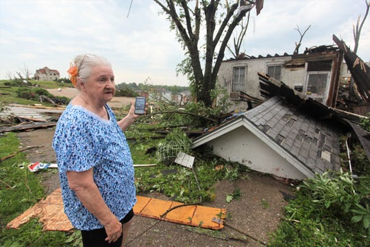 Bettie Jett stands outside her destroyed home in a Jefferson City neighborhood Thursday, May 23, 2019.